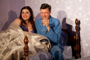 Pamela (Kasey McHale) and Richard (David Vickers) have champagne in bed.Photo: Amelia Beamish