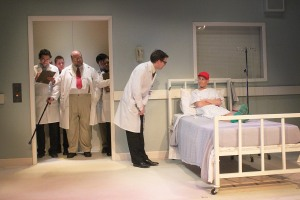Laura Austin, as Dr. Vivian Bearing, and the cast of 'W;t.' Photo: Jessie Dobrzynski