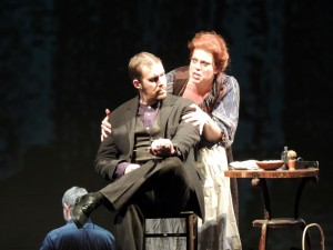 Mrs. Lovett (Jennifer Roderer) comforts the vengeance driven Todd (Kyle Albertson). Photo: Syracuse Opera