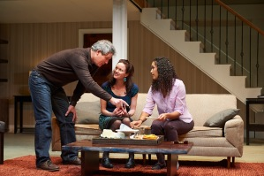 Mike (David Andrew Macdonald),  Margie (Kate Hodge) and Kate (Zoey Martinson) discussing the numerous type of cheese before an unknowing Margie.  Photo: Roger Mastroianni
