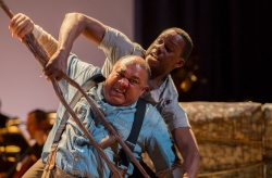 """Porgy (Gordon Hawkins) and Crown (Michael Redding) in """"Porgy and Bess."""" Photo by Doug Wonders"""
