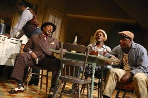 Derrick Lee Weeden (Doaker), G. Valmont Thomas (Wining Boy), Stephen Tyrone Williams (Boy Willie), and Yaegel T. Welch (Lymon) in the Syracuse Stage production of August Wilson's The Piano Lesson. Photographer Michael Davis.