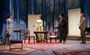 Marianna McClellan (Catherine Givings), Kate MacCluggage (Sabrina Daldry), Brian Keane (Mr. Daldry), and Christopher Kelly (Dr. Givings) in the Syracuse Stage production of In the Next Room, or the vibrator play. Photo by Michael Davis.