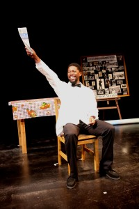 Atandwa Kani in the Syracuse Stage production of Sizwe Banzi is Dead. Photographer Ruphin Coudyzer.