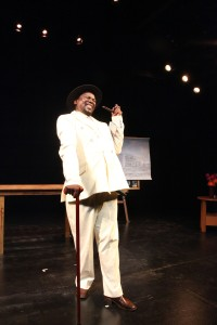 Mncedisi Shabangu in the Syracuse Stage production of Sizwe Banzi is Dead. Photographer Ruphin Coudyzer.